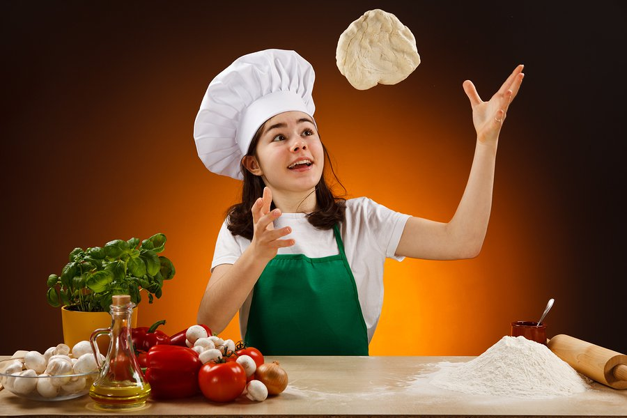 bigstock-Girl-making-pizza-dough-35553185